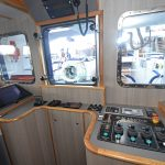 The central trawl console provides a clear view of activity across the transom.