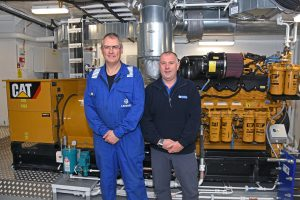 Zephyr chief engineer Brian Irvine and David Henry of DH Marine, with one of the six Caterpillar gensets supplied and installed by DH Marine as part of a bespoke electrical power management system.