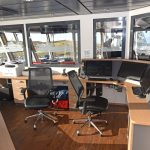 Silhouettes of the family's previous boats are engraved into the windows of the port side office in the wheelhouse.