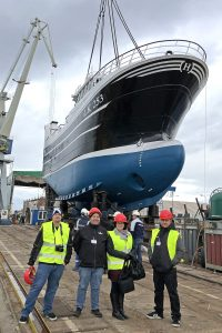 A proud day for Skerries, Shetland as Ocean Challenge is lifted into the water at Gdynia.