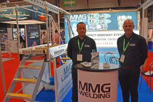 Mark McCallaig and Martin McGuiness standing on one of MMG Welding's vessel-to-vessel Compact Gangway systems.
