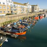 Tying up next to the other fishing boats moored at Brighton Marina.