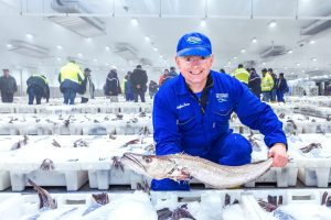 Fishmonger Stephen Bruce is shown in action at Peterhead fishmarket.