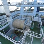 Looking down on the aft boat deck, showing the net drums, the aft pumping arrangements and the purse bin.