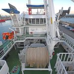 Midwater trawling equipment is arranged over three decks aft of the superstructure casing, as viewed from atop the stern gantry.