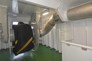 A pump-through hydraulic hose reel connected to the overhead stainless steel delivery pipe is mounted on the shelterdeck.