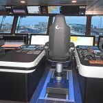 Two NorSap chairs mounted on deck tracks are positioned adjacent to the main forward and island consoles.