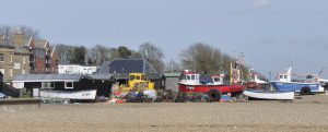 Boats and sheds and shops on the beach at Aldeburgh – the tourists love them…