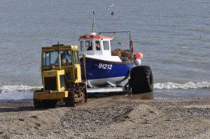 Launching on Aldeburgh's shingle needs tracks and big tyres.