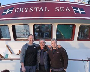 Crystal Sea skippers David and Alec Stevens with their father David Stevens.