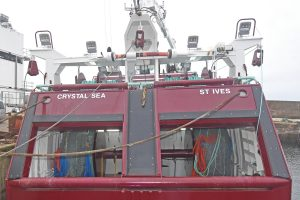Twin-rig trawling arrangements across Crystal Sea's transom.
