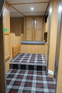 The starboard side three-bed cabin.