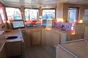 The fishing console is arranged in the aft starboard corner of the wheelhouse.