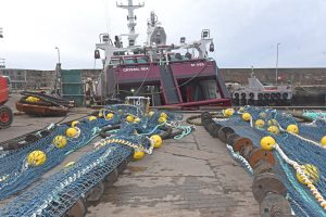 New heavy-duty twin-rig fish scraper nets made by Faithlie Trawl, ready to be pulled onboard Crystal Sea.