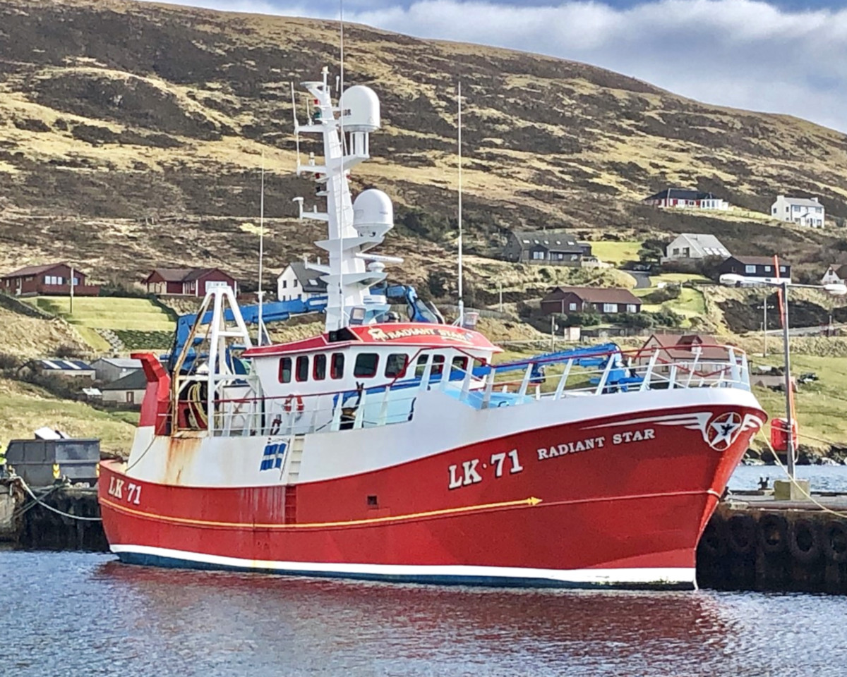 The Burra seiner Radiant Star alongside at Scalloway. (Mick Bayes)