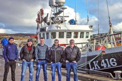 The new owners of Endurance lined up on the quay, shortly after berthing the whitefish trawler in her home port of Symbister for the first time. Left to right: David Irvine (second engineer), Edward Leask (skipper), Grant Irvine (second skipper), Ben Irvine (engineer) and Ian Irvine (shore owner of Ian Irvine Engineering, Whalsay). (Photo: Ivan Reid)