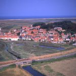 The village of Cley, just downstream of the bank that spelled the end for the Glaven ports – along the line of which the coast road now runs.