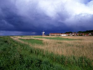 The estuary widened to where Cley was relocated.