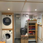 Laundry facilities are included in the deck wardrobe on the starboard side of the deckhouse, abaft the winch compartment.