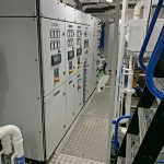 The main electrical cabinets are positioned across the fore end of the engineroom.