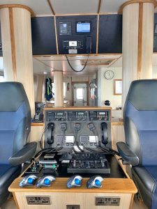 The Navitron autopilot and VHF sets are built into the central island console.