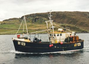 The versatile Dunan Star II heads into the pier at Carloway in East Loch Roag, Lewis.