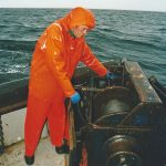 Mate Douglas Craigie runs off wire from the starboard split trawl winch.
