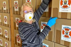 Sue Jay MBE, managing director of MTCIC, preparing to pack 350 Parcels of Kindness for fishermen in Norfolk and Suffolk.