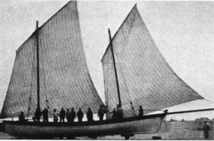 The yawl Happy Return, showing the sail pattern with the mizzen sheeted to the long bumkin. That dipping lug, though a powerful propellant, was a handful to get around the mast on tacking, and could be caught aback by a sudden wind shift, with potentially disastrous consequences.