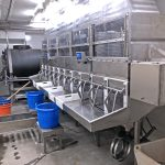Two sets of Marel electronic weighing scales and labelling machines are placed next to 12 receiving bins in the fishroom. A slush ice tank and flake ice ponds lie to starboard.