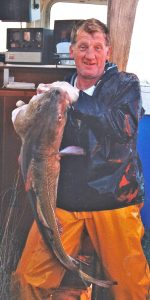 Tom Jenkinson with a good cod.