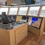 A Woodsons quad-view video wall is central to Aalskere's streamlined wheelhouse interior.