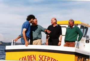 After the sea trials of the first Buccaneer B19 in 2000, designer Gary Mitchell (second from left) seems pleased with what was to become one of the fastest-selling GRP boats of that size.