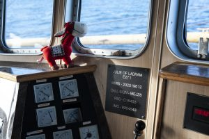 The mascot for the Julie keeps watch in the wheelhouse.