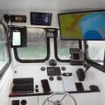 The spacious wheelhouse has an impressive array of electronic gear, all supplied by Comfish Marine.