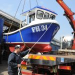 Skipper Daniel Gilbert guiding the Girl Dee Dee on to the lorry ahead of her recent launch at Newlyn.