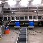 Twelve selection receiving bins are positioned on the aft bulkhead of the fishroom.
