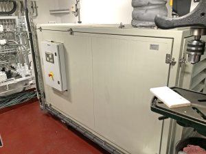 An air-cooled Cummins 6BY harbour genset is housed in a soundproofed cabinet in the main deck workshop.
