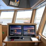 Computer and e-log reporting facilities are provided in a desk area on the starboard side of the wheelhouse.