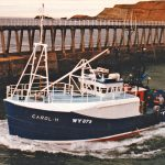 Carol H heads out between the Whitby pier-ends at the beginning of a trip fishing the local inshore hard ground.