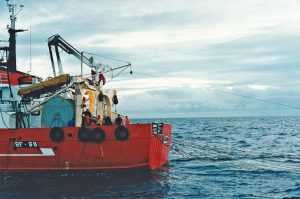 Crew on Convallaria VI wait for Daystar to go alongside to pick up the port sweeps after shooting the midwater trawl.