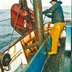 Chaining up the starboard Poly-Ice 7ft trawl door.
