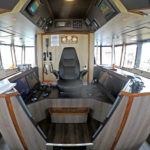 The skipper's chair, flanked by screens on both sides.
