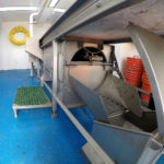 The fish washer is built into the sorting conveyor under Georgina of Ladram's whaleback.