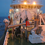 Preparing to pump herring onboard Chris Andra as darkness comes in.