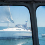 The view from the wheelhouse as a sailing boat gets too close for comfort while dredging is in progress.