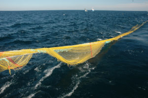 Mending needles (and mugs of tea) to the fore as a badly torn net surfaces after a two-hour tow…