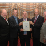 SPSG chairman John Goodlad is presented with the MSC North Sea herring certificate by MSC CE Rupert Howes and first minister Alex Salmond in August 2008.