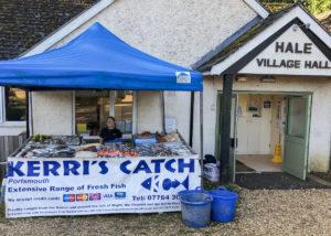 Erin McLeod, Eric's grand-daughter, behind the Kerri's Catch stall in Hale, Surrey.