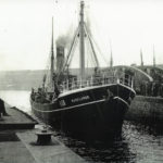 Waveflower, Skipper Oliver's last ship with the Yorkshire Steam Fishing Co, leaves Hull's St Andrew's fish dock on another trip.